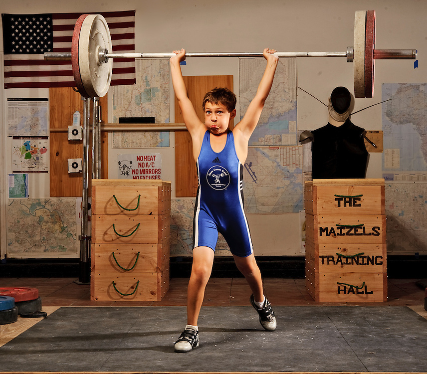 Tyler Maizels, from Parkton, is a nationally ranked bronze medalist in his weight lifting age division.  The eleven-year-old is photographed at his family's home gym Thursday, August 12, 2010. He and his mother Patty Maizels competed in the Maryland State Championships August 16-17 in Frederick, MD.