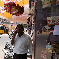 Passerby on a mobile phone in the Muslim section of Chennai. Chennai is the third largest commercial and industrial centre in India. It is considered to be the automobile capital of India, with a major percentage of the country?s automobile industry having a base in the city. Chennai is the second-largest exporter of IT services in India, behind Bangalore and is a base for the manufacture of hardware and electronics, with many multinational corporations setting up plants in its outskirts. The city faces problems with water shortages, traffic congestion and air pollution.