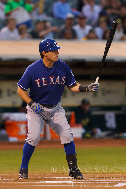 September 20, 2011; Oakland, CA, USA;  Texas Rangers second baseman Ian Kinsler (5) at bat against the Oakland Athletics during the first inning at O.co Coliseum.  Texas defeated Oakland 7-2.