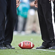 SHOT 9/1/13 5:09:39 PM - A pair of referees stand over the line of scrimmage and the football during the 2013 Rocky Mountain Showdown featuring Colorado versus Colorado State at Sports Authority Field at MiIe HIgh Stadium in Denver, Co. Colorado won the annual in-state rivalry 41-27. (Photo by Marc Piscotty / © 2013)