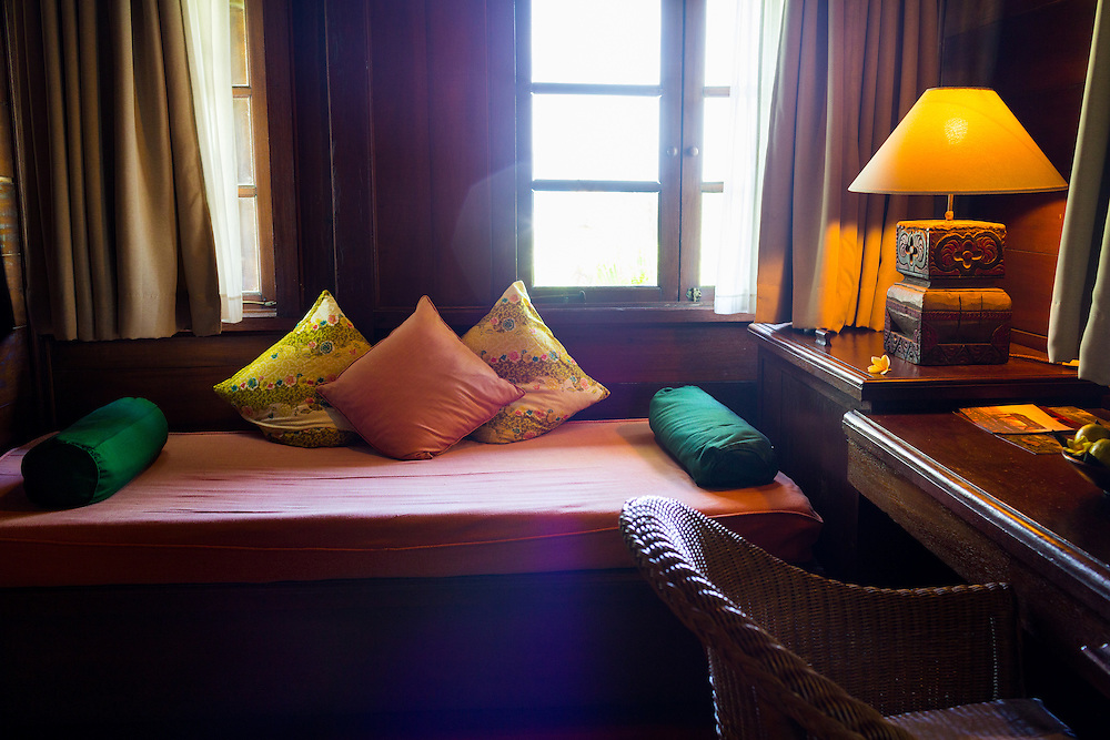 Rejang suite boasts a timber interior, rich deep colors, a carved four-poster bed, and luxurious bathrooms hand-crafted by local artisans, also feature a private spa area with a unique sunken bathtub and a day-bed.