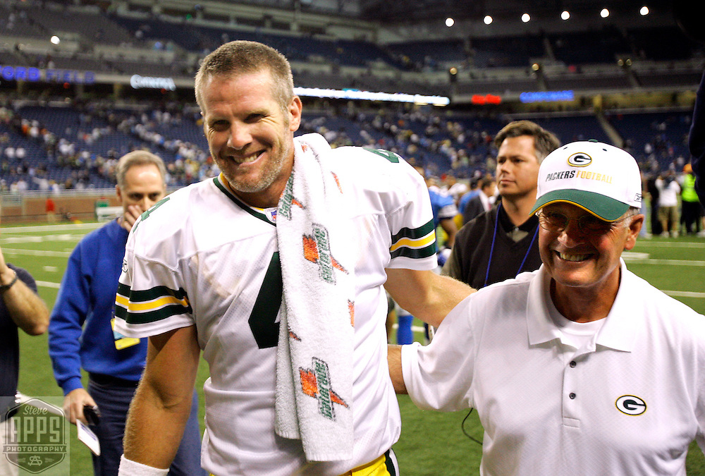 Green Bay's Brett Favre and Head of Security Jerry Parins (?) walk off the field after Packers beat the Lions for their first win of the year. .The Green Bay Packers traveled to Ford Field in Detroit to play the Detroit Lions Sunday September 23, 2006. Steve Apps-State Journal.