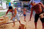 Brick making family near Belic, Granma, Cuba.
