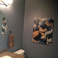 Montauk Rocks perfectly complements the stonework in this powder room.