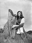 Harpist Mary O'Hara, Clontarf, before leaving for South Africa.28/05/1954..Mary O'Hara (born in Sligo on 12th May 1935) is an Irish soprano and harpist from County Sligo. O'Hara achieved fame on both sides of the Atlantic in the late 1950s and early 1960s. Her recordings of that period influenced a generation of Irish female singers who credit O'Hara with influencing their style, among them Carmel Quinn, Mary Black, and Moya Brennan, among others. In his autobiography Memoirs of an Irish Troubadour (2002) Liam Clancy wrote how O'Hara's music inspired and influenced him and others of the Folk Revival period..Mary won her first competitions, Sligo's annual Music and Drama singing competition, at the age of eight and made before she left school at the age of 16. She went on to perform at Edinburgh International Fringe Festival with the Dublin University Players, BBC's Quite Contrary and The Ed Sullivan Show, before she starred in her own BBC television series. Her first recording contract was with Decca Records. Part of her extensive music career included Mary spending a considerable amount of time on the Aran Islands collecting folk music and acquiring fluent Gaelic..She was introduced to American poet Richard Selig by Irish poet Thomas Kinsella and she married Selig in 1956. She moved to America with him where her star continued to grow. When Selig died of Hodgkin's disease only 15 months after their marriage, O'Hara continued to tour and record for four years..In 1962, she became a nun at Stanbrook Abbey, where she lived for 12 years. Her wedding band was melted down and made into a ring to celebrate her final vows as a nun in 1967..Her initial speedy rise to fame was repeated in 1974 when she left the order and returned to performing. In a matter of months, she become one of the biggest international recording stars to come out of Ireland..Her autobiography is entitled The Scent of the Roses. The title is taken from one of her favourite songs by the Irish poet Thom