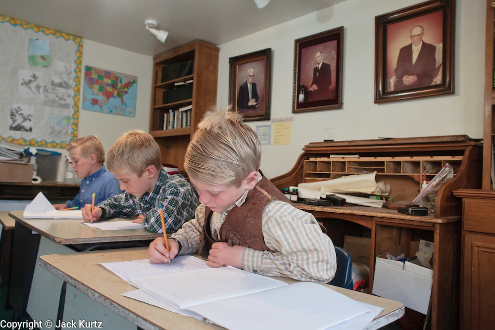 """Sept 8, 2008 -- COLORADO CITY, AZ: Children in the Jessop family are home schooled by adults in the house. The Jessops are polygamist members of the FLDS. Members of the FLDS pulled their children from the public schools several years ago, now most of the families in town home school their children. The Jessops have almost 40 youngsters, in grades kindergarten through 8th grade, in their home school. Colorado City and the neighboring town of Hildale, UT, are home to the Fundamentalist Church of Jesus Christ of Latter Day Saints (FLDS) which split from the mainstream Church of Jesus Christ of Latter Day Saints (Mormons) after the Mormons banned what they call """"Celestial Marriage"""" (polygamy) in 1890 so that Utah could gain statehood into the United States. The FLDS Prophet (leader), Warren Jeffs, has been convicted in Utah of """"rape as an accomplice"""" for arranging the marriage of teenage girl to her cousin and is currently on trial for similar, those less serious, charges in Arizona. After Texas child protection authorities raided the Yearning for Zion Ranch, (the FLDS compound in Eldorado, TX) many members of the FLDS community in Colorado City/Hildale fear either Arizona or Utah authorities could raid their homes in the same way. Older members of the community still remember the Short Creek Raid of 1953 when Arizona authorities using National Guard troops, raided the community, arresting the men and placing women and children in """"protective"""" custody. After two years in foster care, the women and children returned to their homes. After the raid, the FLDS Church eliminated any connection to the """"Short Creek raid"""" by renaming their town Colorado City in Arizona and Hildale in Utah. The Jessops are a polygamous family and members of the FLDS.   Photo by Jack Kurtz / ZUMA Press"""