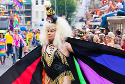 Brighton, August 2nd 2014. A Drag queen displays her finery during Brighton Pride