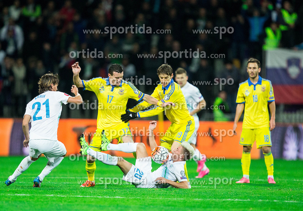 Kevin Kampl (SLO) vs Artem Fedetskiy (UKR) and Denys Garmash (UKR) during the UEFA EURO 2016 Play-off for Final Tournament, Second leg between Slovenia and Ukraine, on November 17, 2015 in Stadium Ljudski vrt, Maribor, Slovenia. Photo by Vid Ponikvar / Sportida