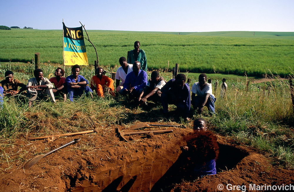 ANC supporters prepare to bury a man killed in political violence, KwaZulu Natal., South Africa. 1993