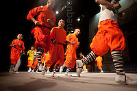 © London News Pictures. 08/06/2011. A rare, behind the scenes, view of the world famous Shaolin Warriors performing there warm up routine before going on stage at the Assembly Halls theatre, Tunbridge Wells. Returning to the stage with a brand new show, this breathtaking theatrical performance vividly showcases the rarely-seen Kung Fu masters' feats of agility, strength and skill as they embark on their gruelling 66 date tour. The troop contains 22 fully trained Kung Fu masters upwards from age 10.Picture credit should read Manu Palomeque/London News Pictures