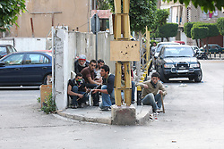 After a day of labor protests by the Hizballah-led opposition workers' union, Lebanon remained tense as a conflict between pro-government and pro-opposition forces seemed inevitable. Road blocks continued by pro-opposition forces throughout Wednesday and into Thursday. It was after a late afternoon press conference by Hizballah leader Hassan Nasrallah that the situation quickly escalated. Soon after the conference concluded, clashes erupted throughout Beirut. In the Cornish al-Mezraa neighborhood Shia militants from the opposition-aligned Amal movement clashed with Sunni militants from the government-aligned Future party who fired back from the densely populated neighborhood of Tariq al-Jadide. Many Lebanese are saying the events were reminiscent of the country's blooy 15-year civil war that ended in 1990. PICTURED: Amal militants carrying Kalishnakovs and rocket-propelled grenade launches take cover and trade shots with Future militants across the Cornish al-Mezraa street in Beirut. The fighting lasted from 5:30 pm on Thursday and throughout the night.