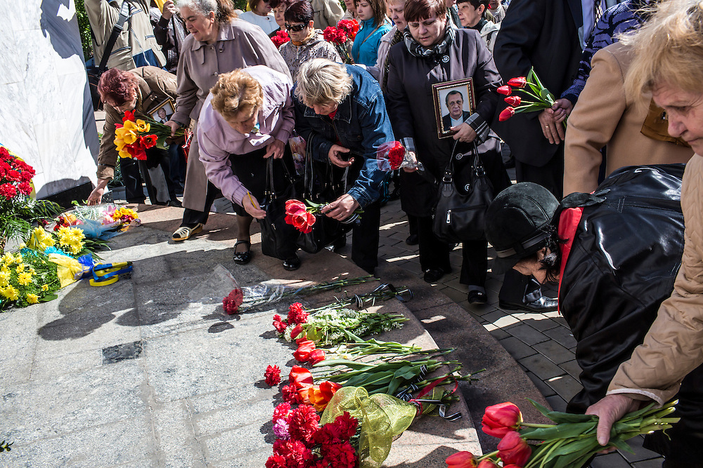 DONETSK, UKRAINE - APRIL 25:  People place flowers during a memorial service commemorating the anniversary of the 1986 Chernobyl nuclear accident on April 25, 2014 in Donetsk, Ukraine. The accident, which took place in the northern part of Ukraine, is considered the worst nuclear accident in history. (Photo by Brendan Hoffman/Getty Images) *** Local Caption ***
