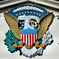 Seal of the President at Herbert Hoover Presidential Museum in West Branch, Iowa<br /> The presidential seal originated with President Fillmore and has evolved several times since then. It always contained an eagle holding an olive branch (symbolizing peace) and three arrows (for war) plus a shield in the middle. This version, called the Bailey Banks &amp; Biddle representation, was designed in 1916 for President Wilson. It is displayed at the Herbert Hoover Presidential Museum in West Branch, Iowa. In 1945, the eagle began facing left and 48 stars were added. Two more stars were added in 1960 after Hawaii and Alaska joined the union.