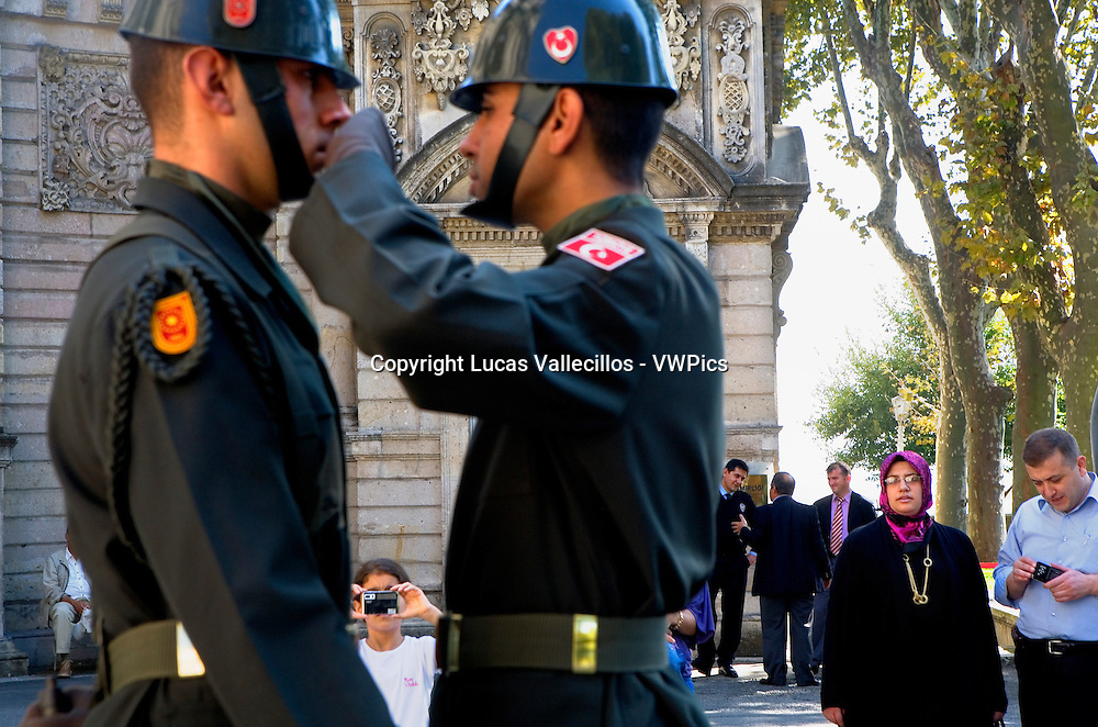 Dolmabahce Palace, guard,soldier, wiping the sweat of another soldier, soldiers and tourists, Istanbul, Turkey