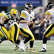 Green Bay Packers' C.J. Wilson putting pressure on Pittsburgh Steelers' Ben Roethlisberger in the 3rd quarter. .The Green Bay Packers played the Pittsburgh Steelers in Super Bowl XLV,  Sunday February 6, 2011 in Cowboys Stadium. Steve Apps-State Journal.