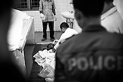 A yet unidentified victim is embalmed at Calmette Hospital in Phnom Penh, Cambodia. Nearly 400 perished on November 22nd 2010 when an unknown event caused panic and thousands tried to flee Diamond Island over a small bridge connecting it to the river bank.