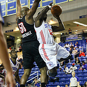 Delaware 87ers Guard Mfon Udofia (12) drives towards the basket as Idaho Stampede Forward Dallas Lauderdale (50) defends in the first half of a NBA D-league regular season basketball game between Delaware 87ers and Idaho Stampede Thursday, Dec. 12, 2013 at The Bob Carpenter Sports Convocation Center, Newark, DE