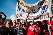 CPS teachers sing for their students at a rally in Logan Square on September 14, 2012.
