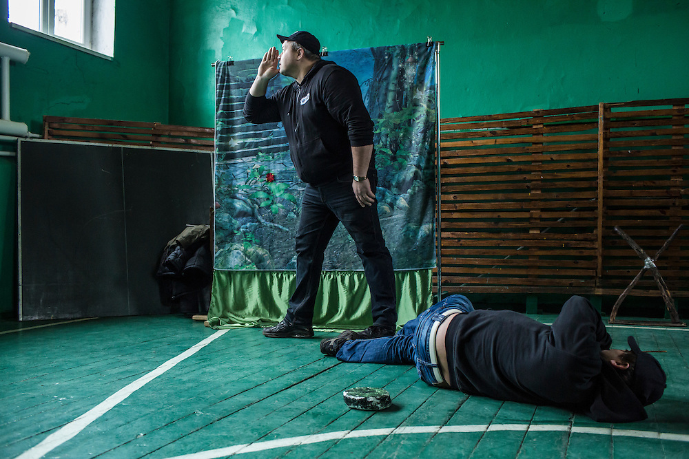 Employees of the Swiss Foundation on Mine Action gives a mine awareness training at School #21 on Tuesday, December 15, 2015 in Scherbynivka, Ukraine.