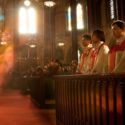 "Chinese Christians pray during a mass for Easter April 7, 2007 in Beijing, China.  Chinese are largely flocking to traditional religions such as Buddhism and Taoism, many are also turning to Christianity and there are now around 10 million or more Catholics in China -- with about a third belonging to an ""underground"" church that has remained loyal to the Vatican despite decades of harsh repression under the Communist Party. (Photo by Ami Vitale)"