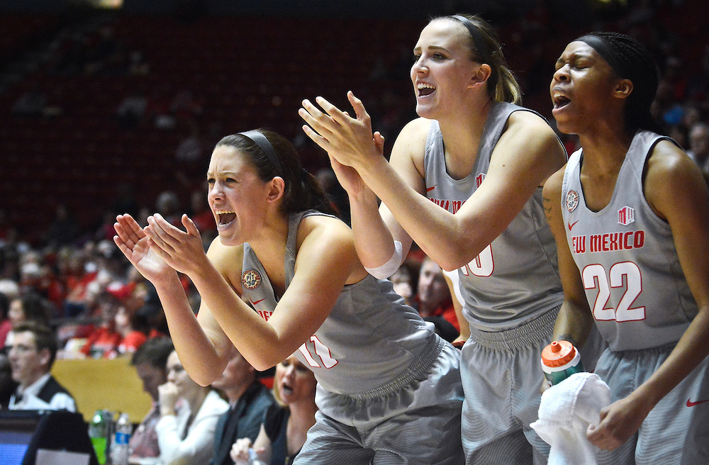 mkb120316a/sports/Marla Brose/120316<br /> From left, University of New Mexico's #11 Emily Lines, #10 Hannah Sjerven, and #22 Mykiel Burleson cheer from the sidelines during the second half of the Lobos game against SMU, Saturday, Dec. 3, 2016, in Albuquerque, N.M. Lobos won 64-49. (Marla Brose/Albuquerque Journal)