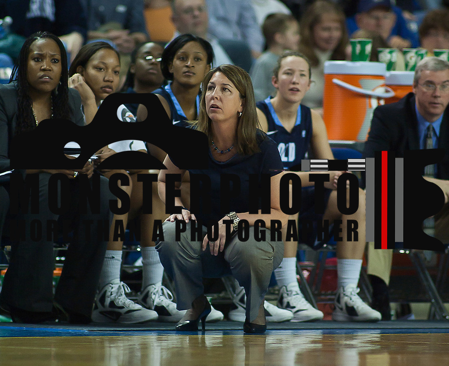 02/09/12 Newark DE: Lady Monarchs Head Coach Karen Barefoot coaching from the sidelines during a Colonial Athletic Association game against Delaware, Feb. 9, 2012 at the Bob carpenter center in Newark Delaware.
