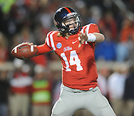 Mississippi quarterback Bo Wallace (14) passes against LSU at Vaught-Hemingway Stadium in Oxford, Miss. on Saturday, October 19, 2013. Mississippi won 27-24. (AP Photo/Oxford Eagle, Bruce Newman)