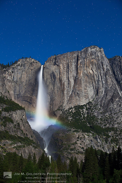 Lunar Rainbow, also known as a moonbow, appears under moonlight over Upper and Lower Yosemite Falls - Yosemite National Park, California