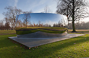 Anish Kapoor, C-Curve 2007,Stainless steel, 220 x 770 x 300 cm. Installation view of Serpentine Gallery exhibition Turning the World Upside Down, Kensington Gardens, London 28 September 2010 - 13 March 2011 (reflection of photographer digitally removed).