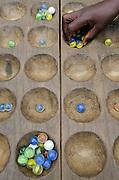 Traditional board game<br /> Mbomo Village<br /> Odzala - Kokoua National Park<br /> Republic of Congo (Congo - Brazzaville)<br /> AFRICA