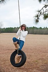 woman having fun on a tire swing