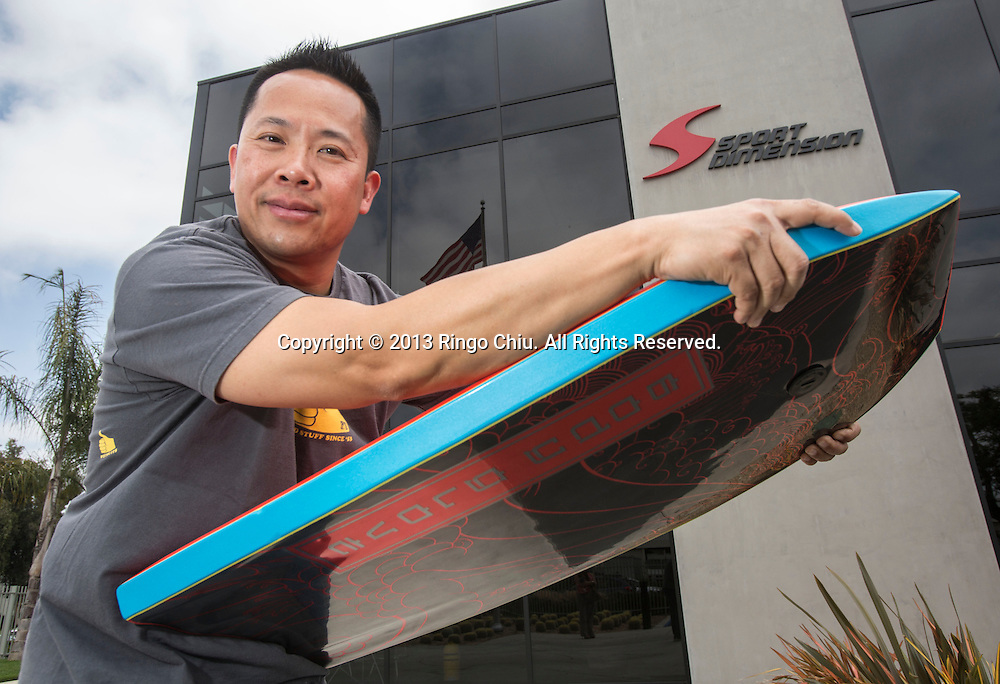 Joseph Lin, CEO of Sport Dimension Inc., makes Body Glove in Carson, California. (Photo by Ringo Chiu/PHOTOFORMULA.com)