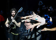 Yannis Philippakis of Foals performs live on stage at Alexandra Palace on February 15, 2014 in London, England.  (Photo by Simone Joyner)