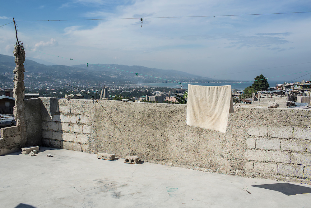 A towel hangs to dry on a line in the Fort National neighborhood on Tuesday, December 16, 2014 in Port-au-Prince, Haiti. One of Port-au-Prince's poorer neighborhoods, Fort National was among the hardest hit by the 2010 earthquake. Still, its residents lack electricity or running water, and only several new homes have been built by the aid organizations and the government, despite years of promises.