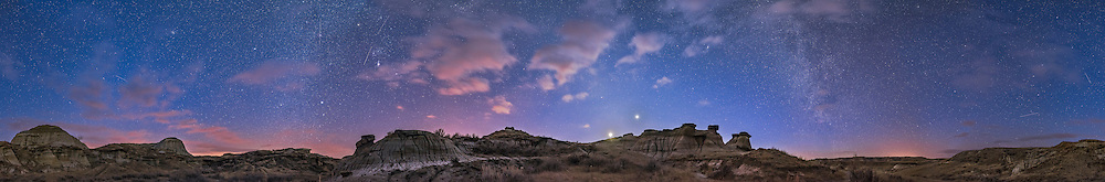 A 360&deg; panorama of the evening twilight sky in winter, on February 28, 2017. The Milky Way is beginning to appear and the Zodiacal Light is at centre in the west. Clouds lit by light pollution colour the sky. The crescent Moon, here overexposed, shines below bright Venus, with Mars much fainter to the left of Venus. Orion stands to the south at left of centre, partly in clouds. Numerous satellite trails appear in the blue twilight sky. Leo is rising at far left; the Big Dipper is at far right. <br /> <br /> This is a stitch of 10 segments, each 25 seconds at f/2.8 with the 20mm Sigma Art lens and Nikon D750 at ISO 3200. Stitched with PTGui. Camera Raw did the job but did not allow for positioning the scene to put what I wanted at the centre. The original is 26,000 x 4,300 pixels. Taken from the Trail of the Fossil Hunters.