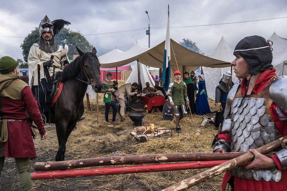 Men dressed in armor ride horses during a medieval festival on Saturday, September 24, 2016 in Mstislavl, Belarus.