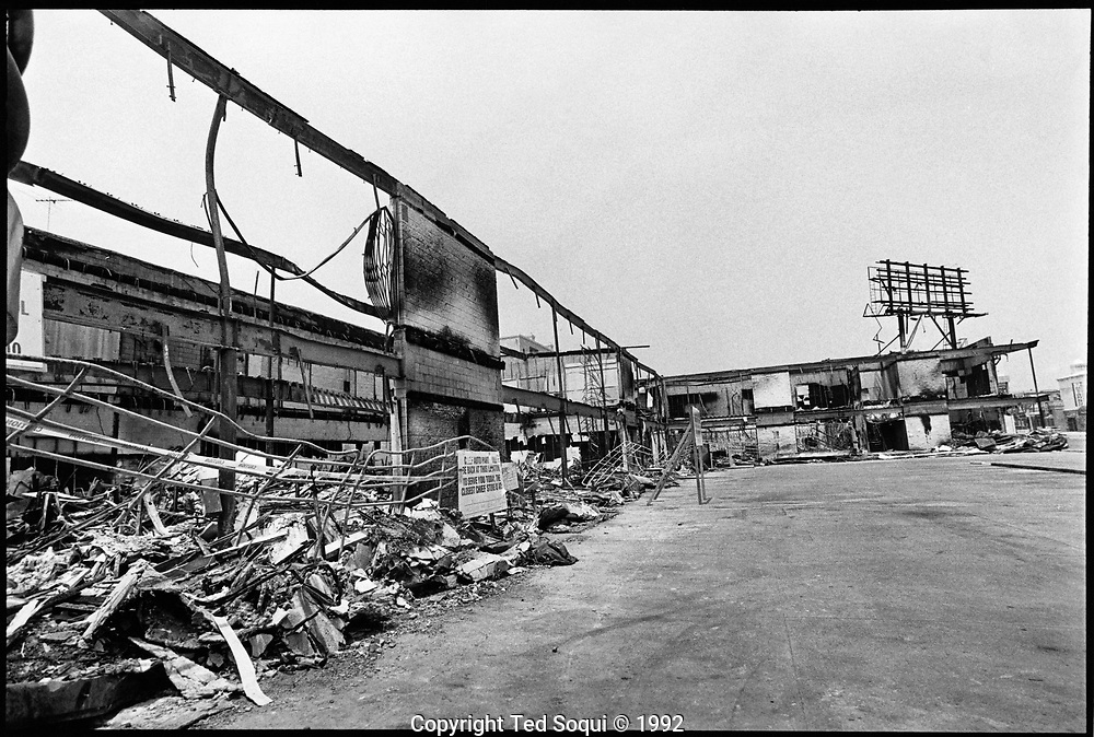 A mini mall on 6th Street and Western Ave in Koreatown was burned down to the ground during the 1992 riots.<br /> <br /> 25 before and after LA92 photo project.