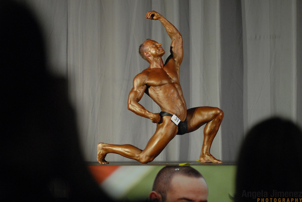 Greg Eder, of Auckland, New Zealand, poses during the Physique (bodybuilding) competition 40-49 year old age group lightweight division at McGaw Memorial Hall/Welsh-Ryan Arena at Northwestern University in Evanston, Illinois during the Gay Games VII competition on July 19, 2006. <br />  <br /> <br /> Eder won the modified championship in his division. <br /> <br /> Over 12,000 gay and lesbian athletes from 60 countries are in Chicago competing in 30 sports during the Games from July 15 through 22, 2006. <br /> <br /> Over 50,000 athletes have competed in the quadrennial Games since they were founded by Dr. Tom Wadell, a 1968 Olympic decathlete, and a group of friends in San Francisco in 1982, with the goal of using athletics to promote community building and social change. <br /> <br /> The Gay Games resemble the Olympics in structure, but the spirit is one of inclusion, rather than exclusivity. There are no qualifying events or minimum or maximum requirements.<br /> <br /> The Games have been held in Vancouver (1990), New York (1994), Amsterdam (1998), and Sydney (2002).