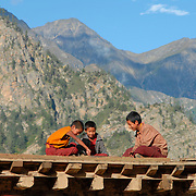 Young monks play carrom - a game similar to pool but using fingers and chips instead of cues and balls - on the rooftop of Yalbang Gompa in remote Humla, west Nepal.