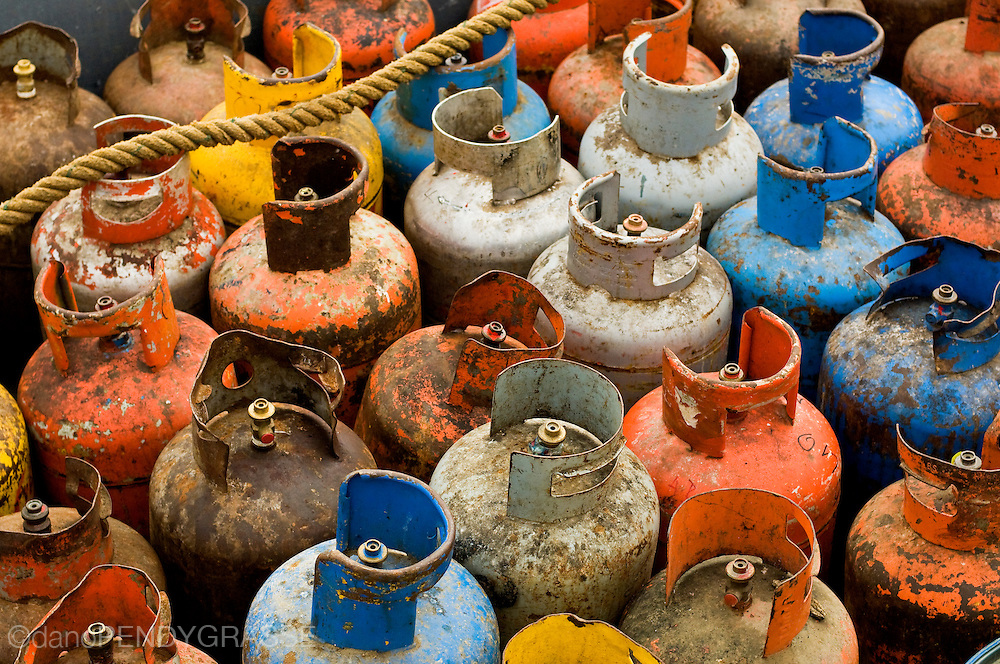 Discarded propane bottles are shipped off the island of Roatan to be processed on the mainland city of La Ceiba, Honduras.