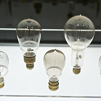 New York. American Museum of Natural Histoty. Exhibiiton on Climate Change: The Threat to Life and A New Energy Future. Light bulbs from the late 1800s?early 1900s.Electric light was a revelation: bright, constant and safe. The first light bulbs, though small and inefficient, gave off 20 times the light of a candle. The discovery caught on quickly; American light-bulb inventor Thomas Edison opened his Lower Manhattan electricity generating station in 1882 and within 14 months had 508 subscribers.