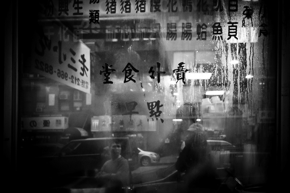 Chinese letters on a store window full of condensation in Chinatown, Manhattan, New York, 2010.