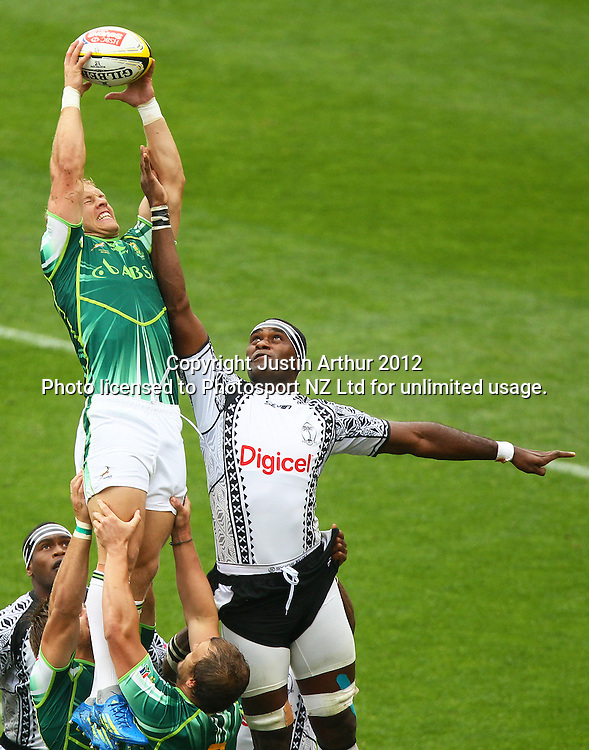South Africa's Kyle Brown  and Fiji's Sokonaia Kalou compete for the ball  .Hertz Wellington Sevens - Day two at Westpac Stadium, Wellington, New Zealand on Saturday, 4 February 2012. Photo: Justin Arthur / photosport.co.nz