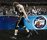 Butler's Matt Howard wipes his faces as he leaves the court after loosing to Connecticut in the Championship game of the 2011 Men's NCAA basketball tournament. This was the second year in a row the small school made it to the final game and lost..