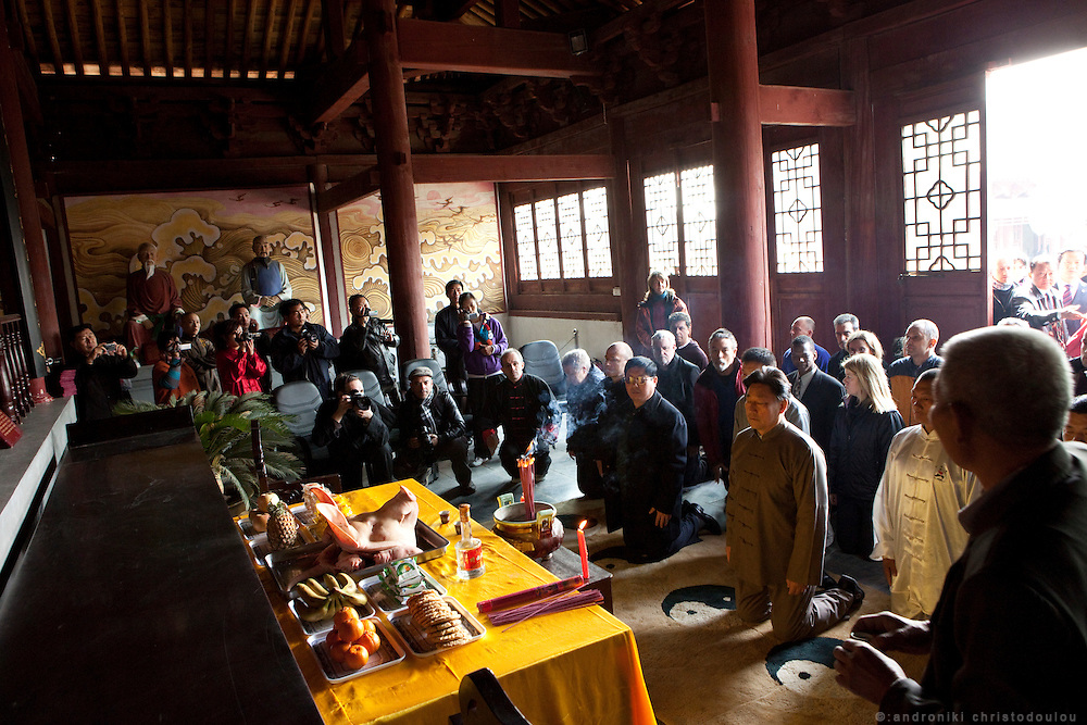 Grandmaster Chen Xiaowang in the mausoleum of the founder of Taijiquan and 9th generation of Chen family Chen Wangting (1600-1680), during a ceremony to accept a number of students as his official students and new members of the Chen family.