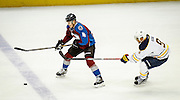 SHOT 2/25/17 10:15:57 PM - The Colorado Avalanche's Tyson Barrie #4 tries to stick handle past the Buffalo Sabres' Evander Kane #9 during their NHL regular season game at the Pepsi Center in Denver, Co. The Avalanche won the game 5-3. (Photo by Marc Piscotty / © 2017)
