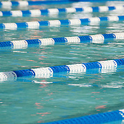 Lane lines in an outdoor competition swimming pool.