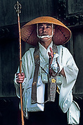 Image of a pilgrim with mala beads in Koya-san, Japan