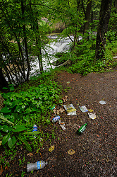Litter next to an unnamed waterfall on Dunloup Creek near the abandoned mining town of Thurmond, in the New River Gorge National River in West Virginia.