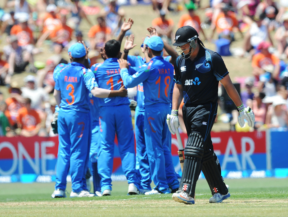 New Zealand's Jessie Ryder walks bowled out by India's Mohammed Shami for 18 in the first one day International cricket match, McLean Park, New Zealand, Sunday, January 19, 2014. Credit:SNPA / Ross Setford